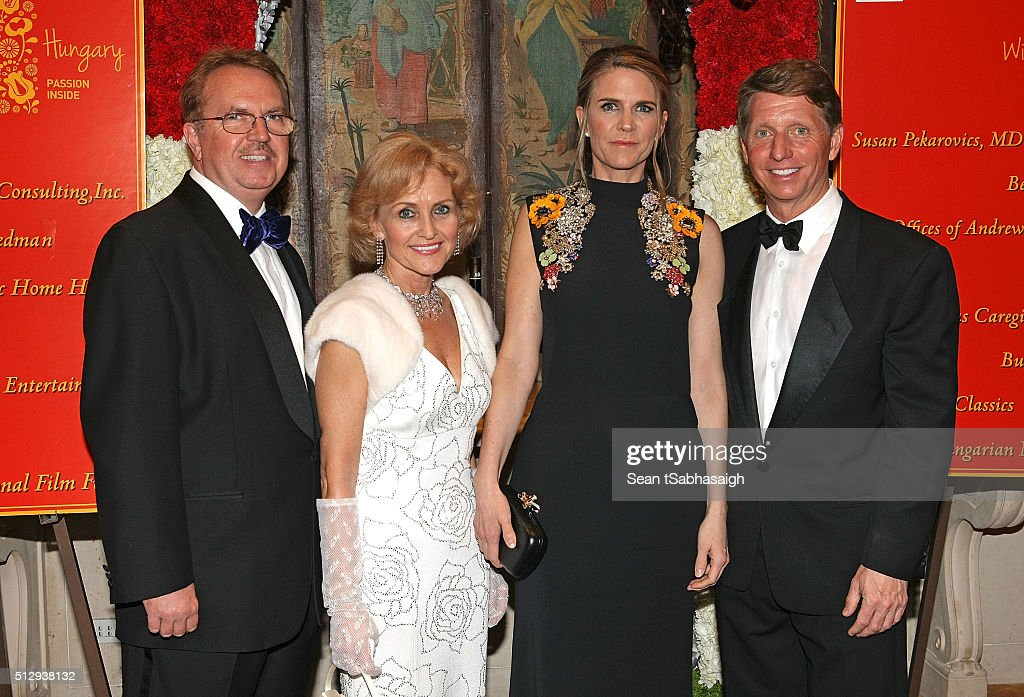 Hungarians in Hollywood hosts Atilla Beres and wife Susan Pekarovics pose on the red carpet with United States ambassador to Hungary Colleen Bradley Bell and husband, writer and TV producer bradley P Bell at the Pre-Oscar Hungarians in Hollywood Gala celebrating the Academy Award nominated film Son of Saul at the Peninsula Hotel on February 27, 2016 in Beverly Hills, California.