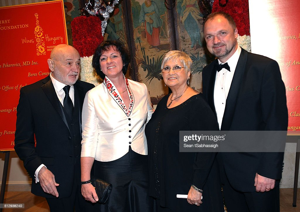 Hungarians in Hollywood hosts Bela Bunyik (L) and wife Bonnie Bunyik (Ct Rt) pose with Hungarian Ambassador to the United States Reka Szemerkenyi (Ct Lt) and husband Ferencz Szabolcs (Rt) on the red carpet at the Pre-Oscar Hungarians in Hollywood Gala celebrating the Academy Award nominated film Son of Saul at the Peninsula Hotel on February 27, 2016 in Beverly Hills, California.