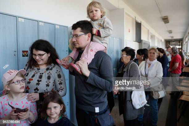 Hungarians wait to vote polling station booth on April 8 2018 in Budapest Hungary Hungarians are going to the polls in the Parliamentary election...