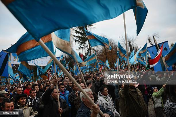 Hungarians wave Szekler flags during a protest in Sfantu Gheorghe city November 8 2012 Around 1000 Romanian Hungarians from Covasna county gathered...
