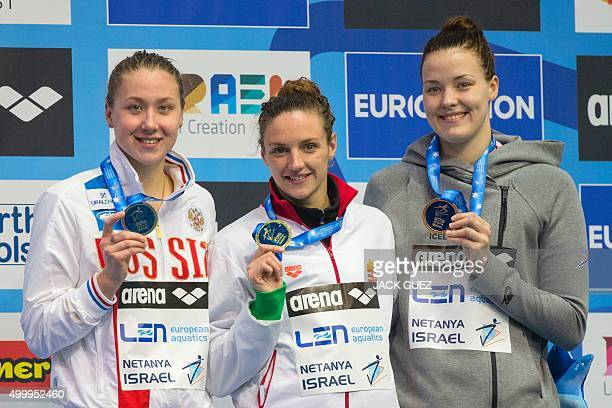 Hungaria's gold medalist Katinka Hosszu Russia's silver medalist Daria K Ustinova and Iceland's bronze medalist Eyglo Osk Gustafsdottir stand on the...