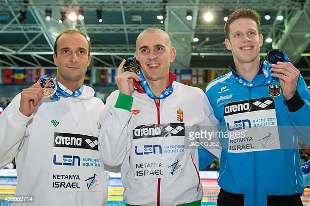 Hungaria's gold medalist Laszlo Cseh Germany's silver medalist Philip Heintz and Portugals bronze medalist Diogo Filip Sjoedin stand on the podium...