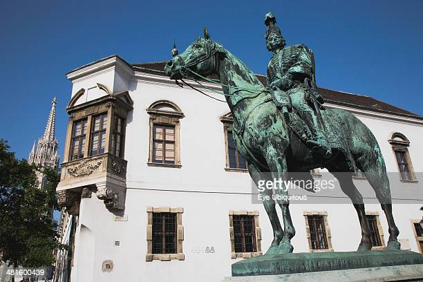 Bronze statue of mounted Hussar with Matyas Church tower behind
