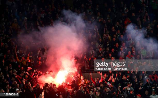 Hungary fans light flares during the UEFA Euro 2020 qualifier between Wales and Hungary so at Cardiff City Stadium on November 19 2019 in Cardiff...