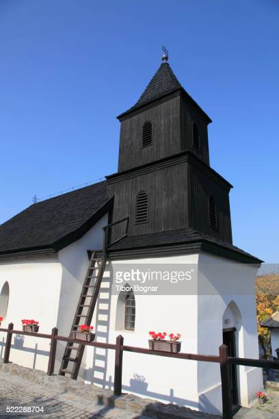 hungary, holl—koý, traditional village, church, - hungarian culture stock pictures, royalty-free photos & images