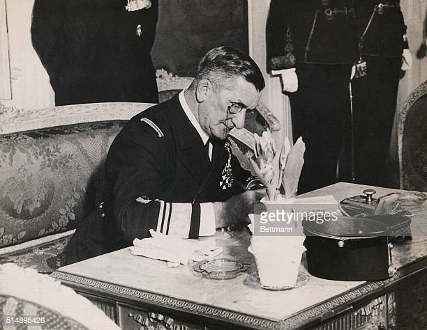 Miklos Horthy Hungarian admiral Statesman signing papers at his desk