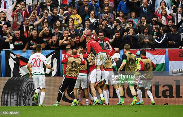 Hungary players celerbate their second goal in front of supporters during the UEFA EURO 2016 Group F match between Austria and Hungary at Stade...