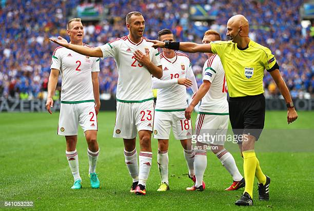 Hungary players confront the referee after the first penalty was given during the UEFA EURO 2016 Group F match between Iceland and Hungary at Stade...