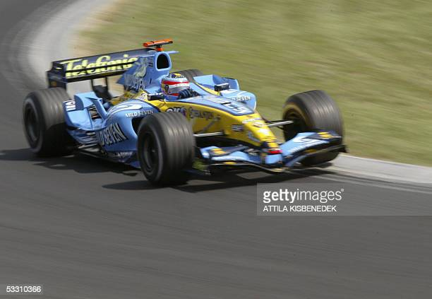 Renault Spanish driver Fernando Alonso steers his car on the Hungaroring racetrack during the Hungarish Grand Prix, 31 July 2005 in Budapest,...