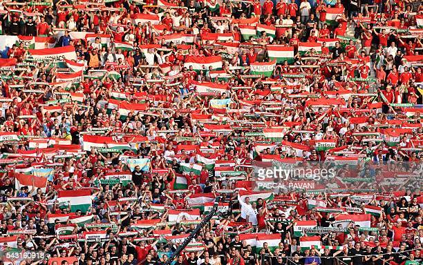 Hungary supporters wave scarves during the Euro 2016 round of 16 football match between Hungary and Belgium at the Stadium Municipal in Toulouse on...