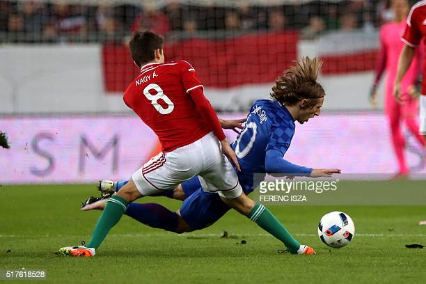 Hungary's Adam Nagy and Croatia's Luka Modric vie for the ball during the friendly football match Hungary v Croatia at the Ferenc Puskas Stadion in...