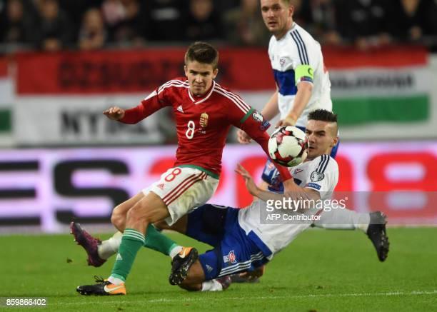 Hungary's Adam Nagy vies with Faroe Islands' Rene Joensen during the FIFA World Cup 2018 qualification football match between Hungary and Faroe...
