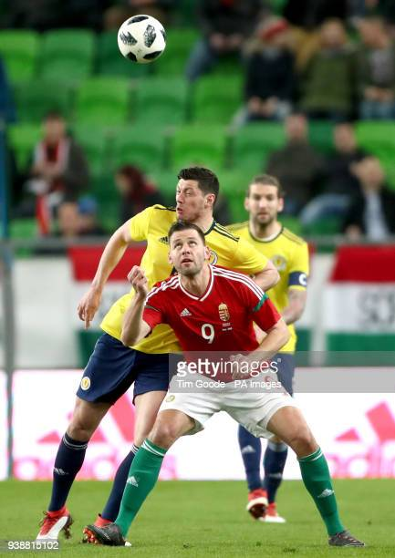 Hungary's Adam Szalai and Scotland's Scott McKenna battle for the ball during the international friendly match at the Groupama Arena Budapest