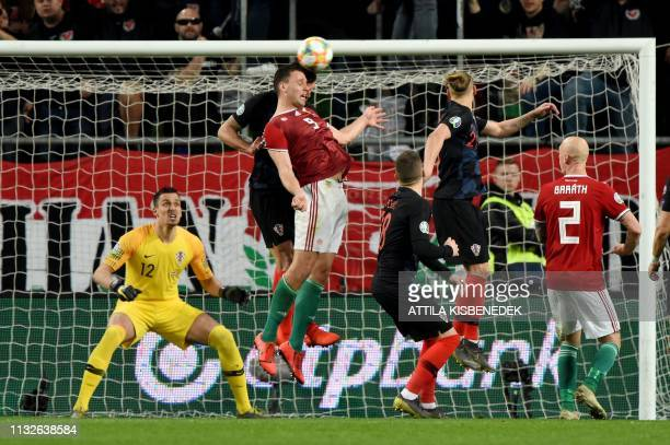 Hungary's Adam Szalai heads the ball during the UEFA Euro 2020 football 1st round Groupe E qualification match between Hungary and Croatia on March...
