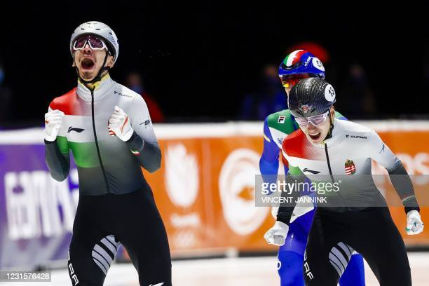 Hungary's Andor Liu Shaolin react as he crosses the finish line to win in the 1000 meters final ahead of Hungary's Shaoang Liu on the final day of...