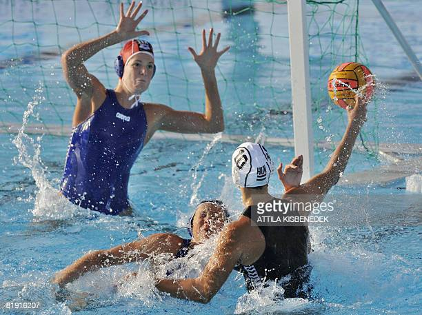 Hungary's Aniko Pelle prepares her shoot as she faces Italian goalkeeper Elena Gigli and Elisa Casanova in the aquatic center swimming pool of...