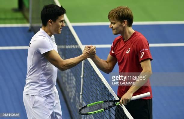 Hungary's Attila Balazs congratulates Belgian David Goffin after the singles match between Belgium's David Goffin and Hungary's Attila Balazs in the...