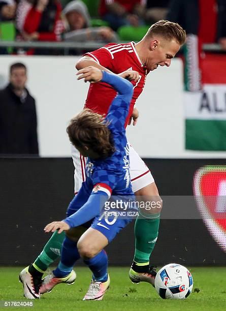 Hungary's Balazs Dzsudzsak vies with Croatia's Luka Modric during the friendly football match Hungary v Croatia at the Ferenc Puskas Stadion in...