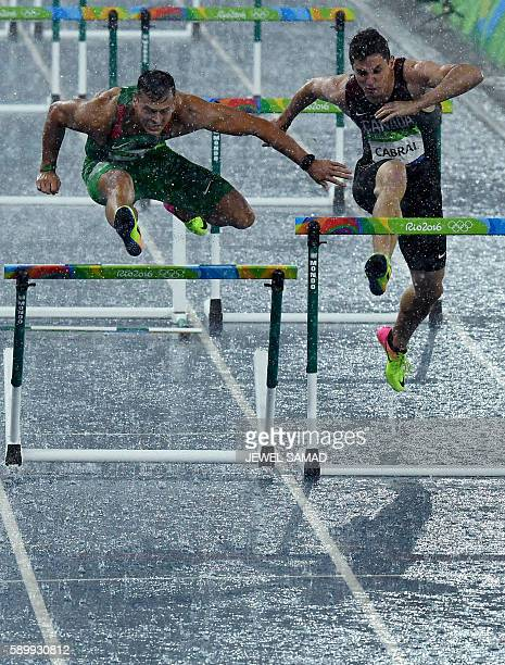 Hungary's Balzs Baji and Canada's Johnathan Cabral compete in the Men's 110m Hurdles Round 1 during the athletics event at the Rio 2016 Olympic Games...