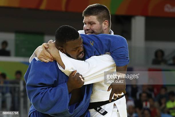 Hungary's Barna Bor competes with Cuba's Alex Garcia Mendoza during their men's 100kg judo contest match of the Rio 2016 Olympic Games in Rio de...