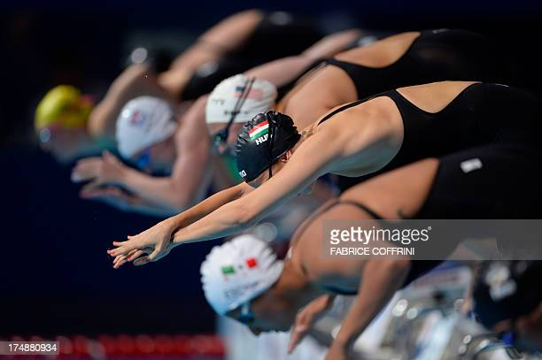 Hungary's Boglarka Kapas competes in the heats of the women's 1500metre freestyle swimming event in the FINA World Championships at Palau Sant Jordi...