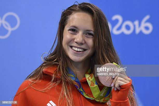 Hungary's Boglarka Kapas poses with her bronze medal on the podium of the Women's 800m Freestyle Final during the swimming event at the Rio 2016...