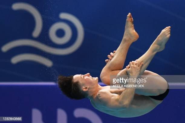 Hungary's Botond Bota competes in the preliminary for the Men's 1m Springboard Diving event during the LEN European Aquatics Championships at the...