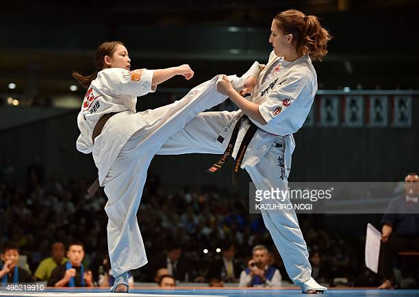Hungary's Csenge Szepesi and Japan's Juri Minamihara fight during the women's final match of the 11th World Karate Championship in Tokyo on November...