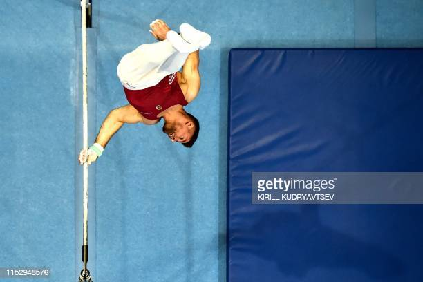 Hungary's David Vecsernyes competes in the horizontal bar event of the men's apparatus final of the Artistic Gymnastics at the 2019 European Games in...