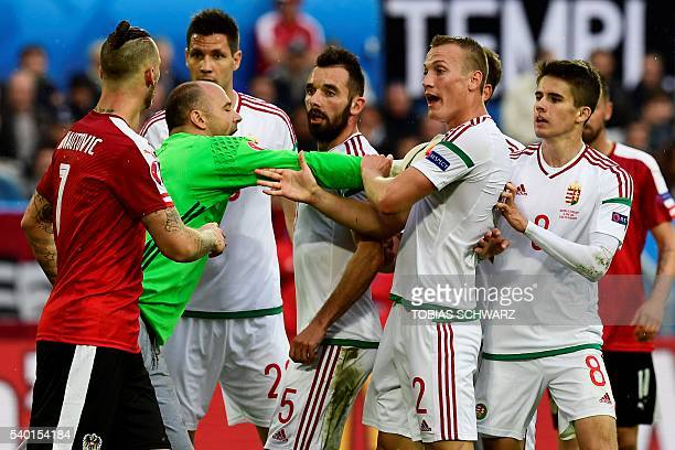 Hungary's defender Adam Lang argues with Austria's forward Marko Arnautovic during the Euro 2016 group F football match between Hungary and Austria...