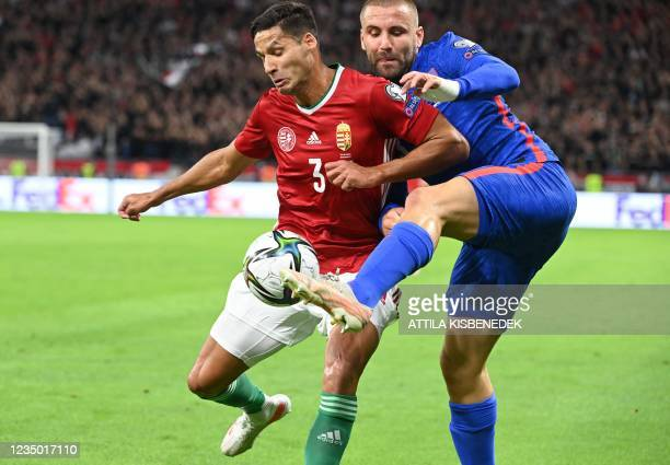 Hungary's defender Akos Kecskes and England's defender Luke Shaw vie for the ball during the FIFA World Cup Qatar 2022 qualification Group I football...