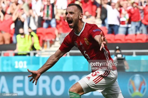 Hungary's defender Attila Fiola celebrates scoring the opening goal during the UEFA EURO 2020 Group F football match between Hungary and France at...