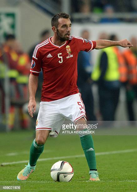 Hungary's defender Attila Fiola plays the ball during the UEFA 2016 European Championship qualifying round Group F football match Hungary vs Finland...