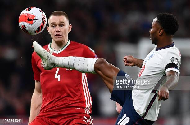 Hungary's defender Attila Szalai vies with England's midfielder Raheem Sterling during the FIFA World Cup 2022 qualifying match between England and...