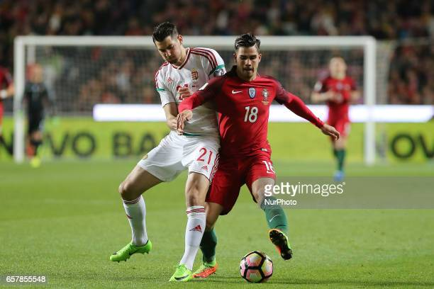 Hungarys defender Barnabas Bese and Portugals forward Andre Silva during Portugal v Hungary FIFA 2018 World Cup Qualifier at Estadio da Luz on March...