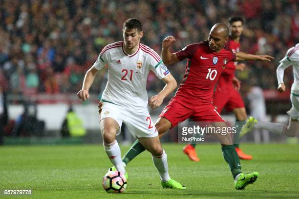Hungary's defender Barnabas Bese vies with Portugal's midfielder Joao Mario during the FIFA World Cup Russia 2018 qualifier match Portugal vs Hungary...