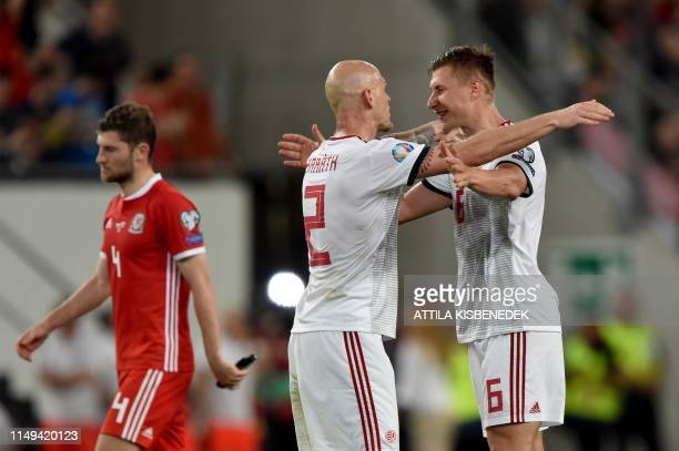 Hungary's defender Botond Barath and defender Willi Orban celebrate during the UEFA Euro 2020 qualifier Group E football match Hungary against Wales...