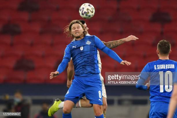 Hungary's defender Endre Botka and Iceland's midfielder Birkir Bjarnason vie for the ball during the UEFA European Qualifiers play-off final football...