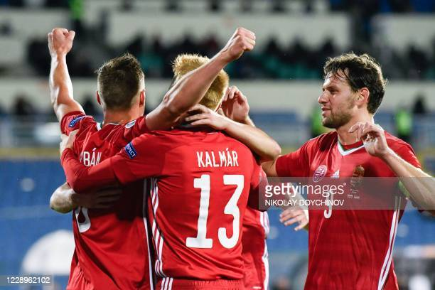 Hungary's defender Willi Orban celebrates with teammates after scoring a goal during the UEFA Euro 2020 Play-off Semi-Final football match between...