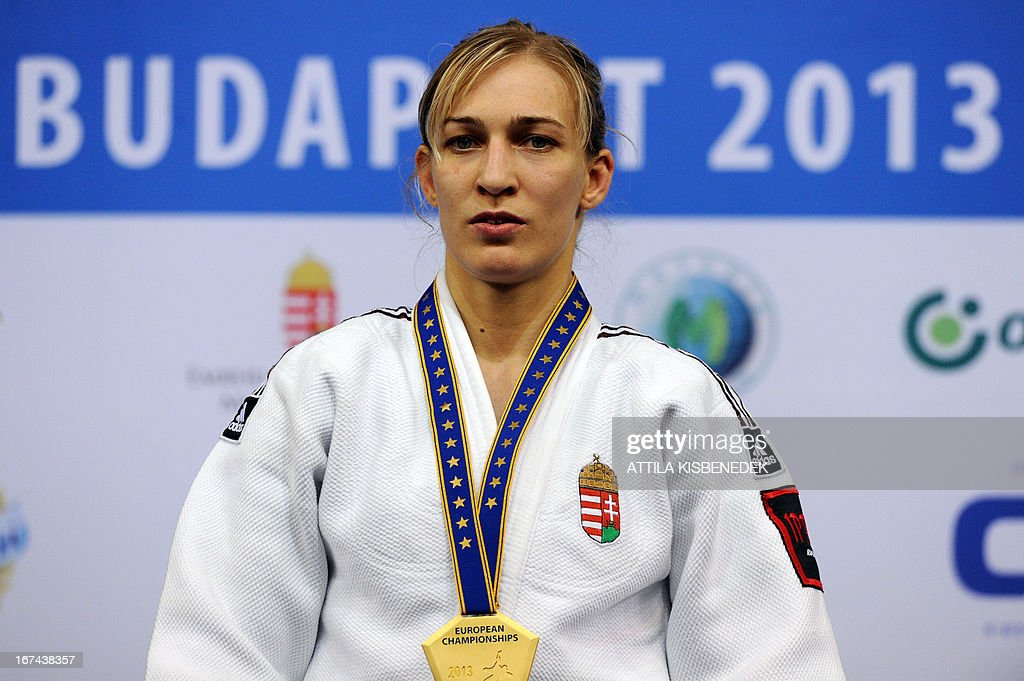 Hungary's Eva Csernoviczki celebrates her gold medal on the podium during the medal ceremony of the Judo European Championships in 48kg category for women in Budapest.