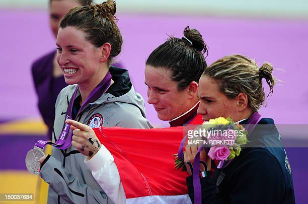 Hungary's Eva Risztov poses with her gold medal flanked by silver medalist Haley Anderson of the United States and bronze medalist Italy's Martina...