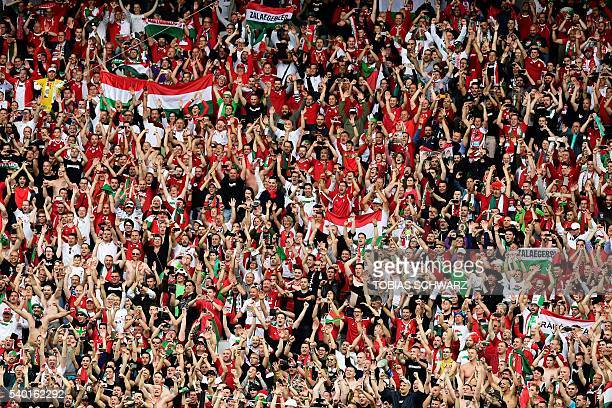 Hungary's fans celebrate at the end of the Euro 2016 group F football match between Hungary and Austria at the Matmut Atlantique stadium in Bordeaux...