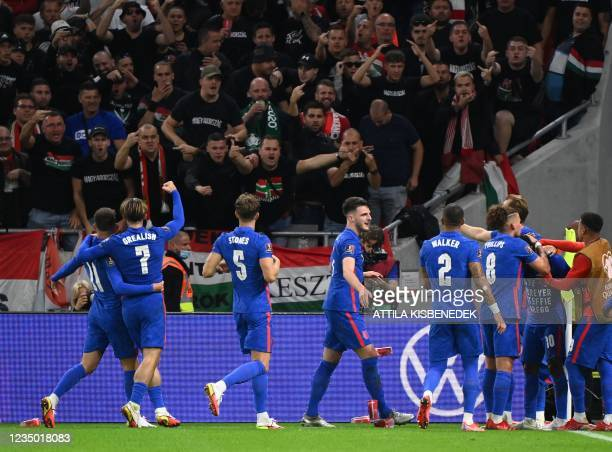 Hungary's fans react as England's team celebrates the 0-1 during the FIFA World Cup Qatar 2022 qualification Group I football match between Hungary...