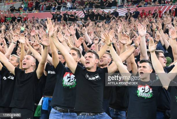 Hungary's fans react prior to the FIFA World Cup Qatar 2022 qualification Group I football match between Hungary and England, at the Puskas Arena in...