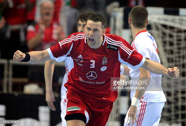 Hungary's Ferenc Ilyes celebrates his score against Croatia during the men's European Handball Championships qualification match of Hungary vs...