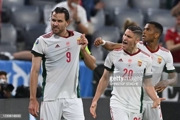 Hungary's forward Adam Szalai celebrates scoring the opening goal with his teammates during the UEFA EURO 2020 Group F football match between Germany...