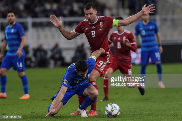 Hungary's Forward Adam Szalai vies with Greece's Defender Sokratis Papastathopoulos during the UEFA Nations League football match between Greece and...
