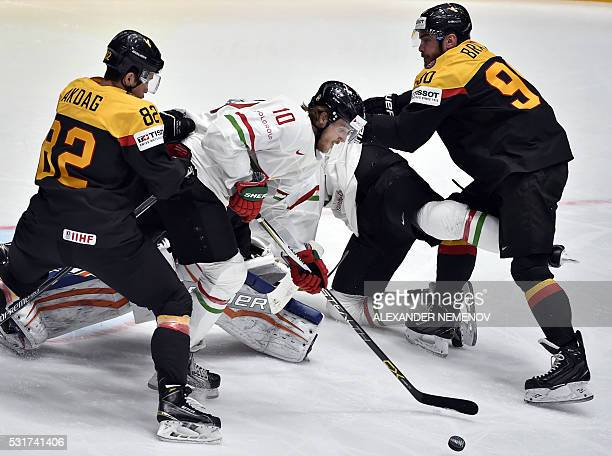Hungary's forward Gergo Nagy vies with Germany's defenders Sinan Akdag and Constantin Braun during the group B preliminary round game Germany vs...
