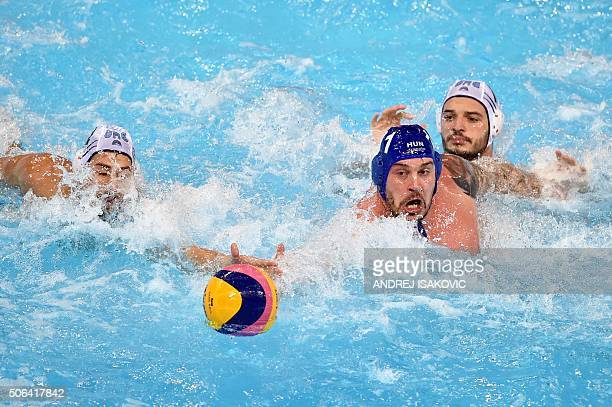 Hungary's Gabor Kis vies for the ball with Greece's Angelos Vlachopoulos and Alexandros Evgenios Gounas during the bronze medal match between Greece...