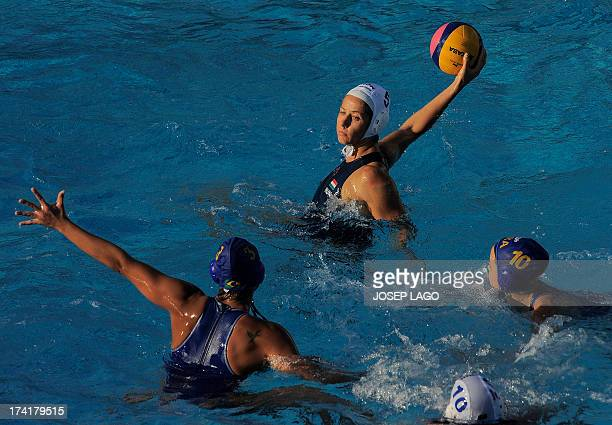 Hungary's Gabriela Szucs fights for the ball with Brazil's Marina Zablith and Brazil's Flavia Vigna during the preliminary rounds of the women's...